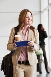 Businesswoman in Airport with a latte