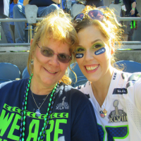 Nichole and her mother enjoying the game.